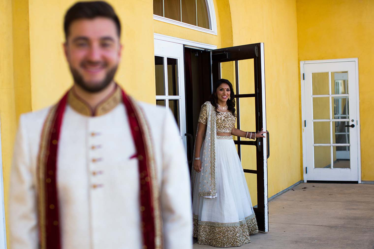 bride and groom first look at meritage resort and spa