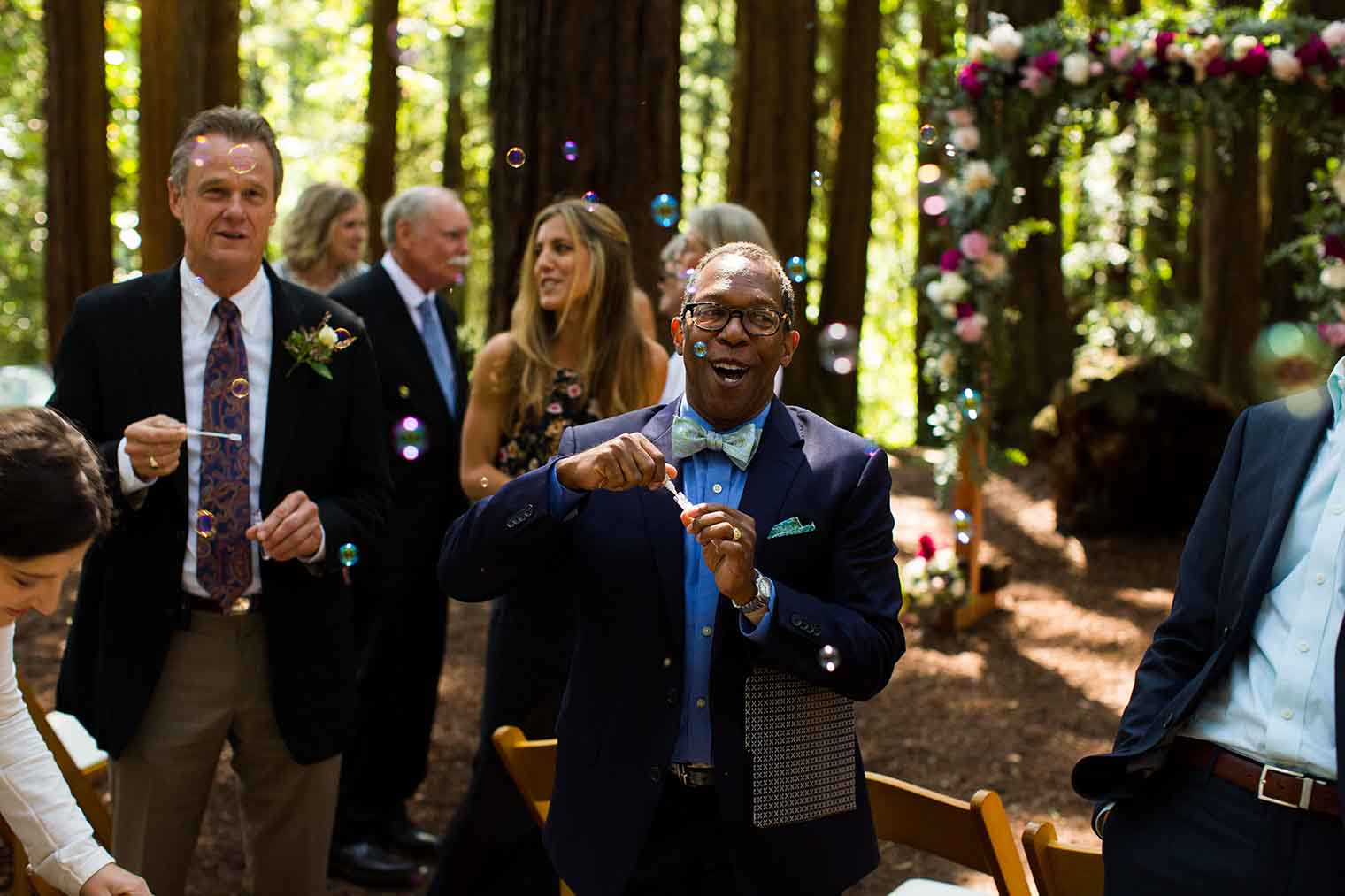 Wedding Guest with bubbles at Redwood Ceremony