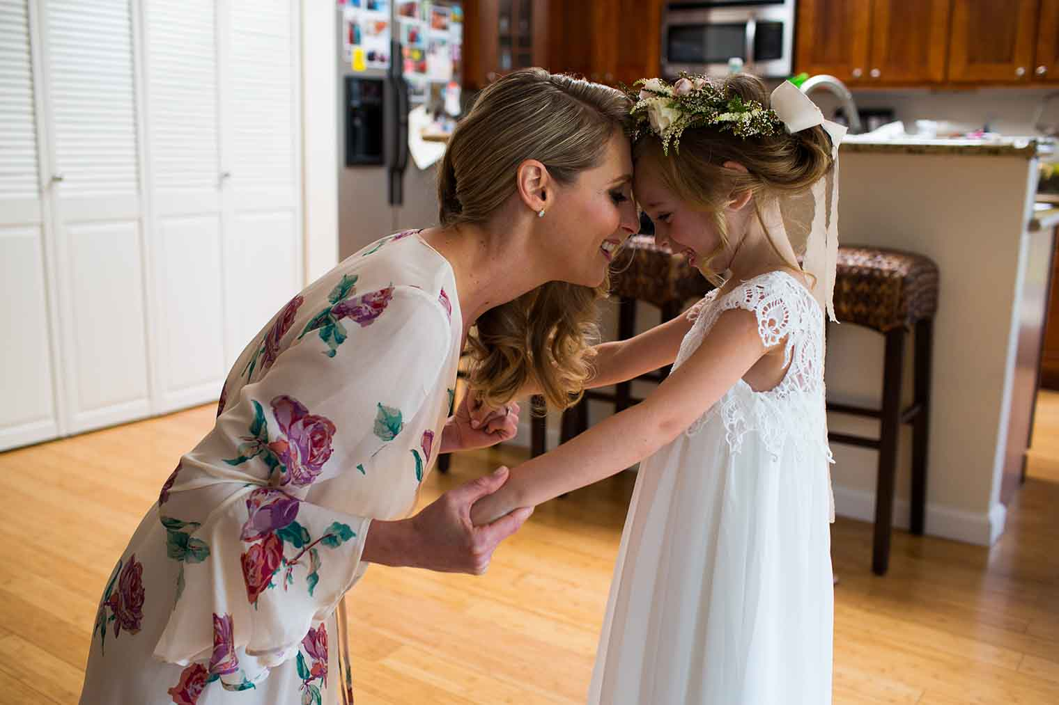 Bride and Flower Girl Candid Moment