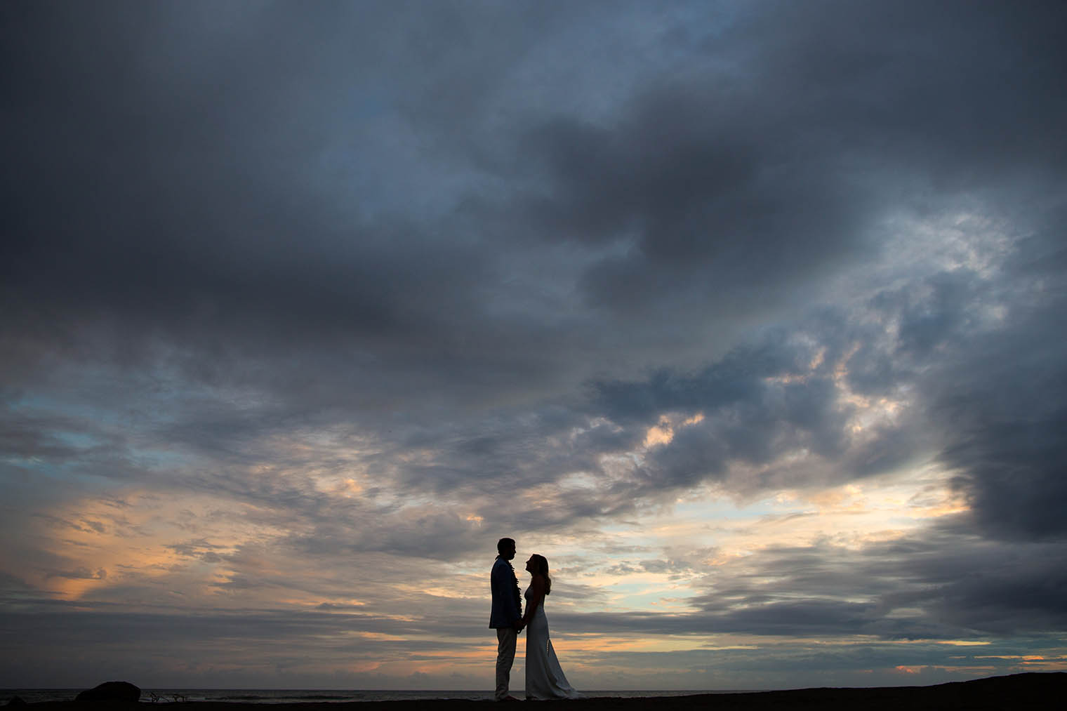 sunset photos of bride and groom at Kekaha Harbor House