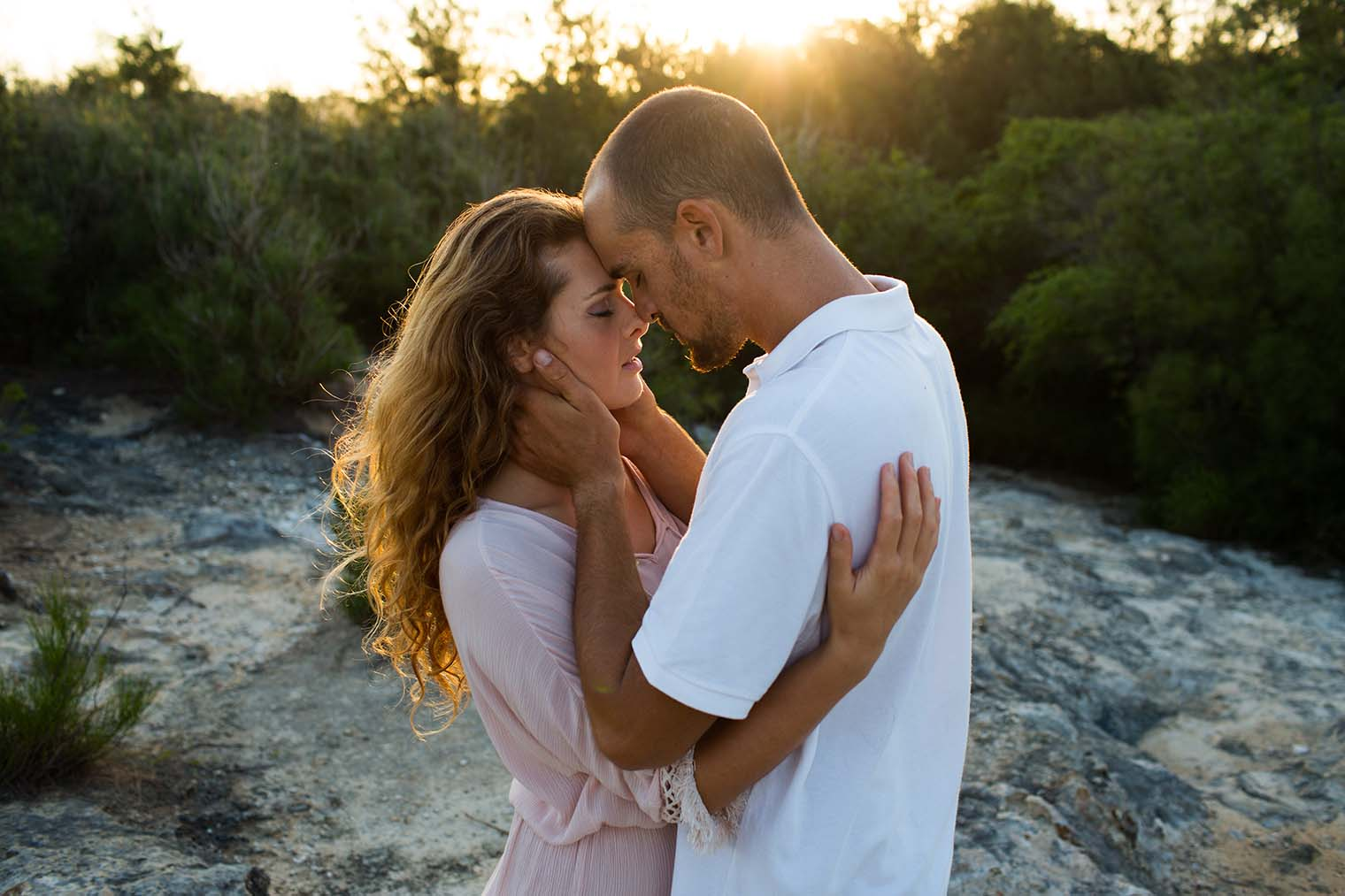 Sunset engagement photos at Maha'ulepu Trailhead