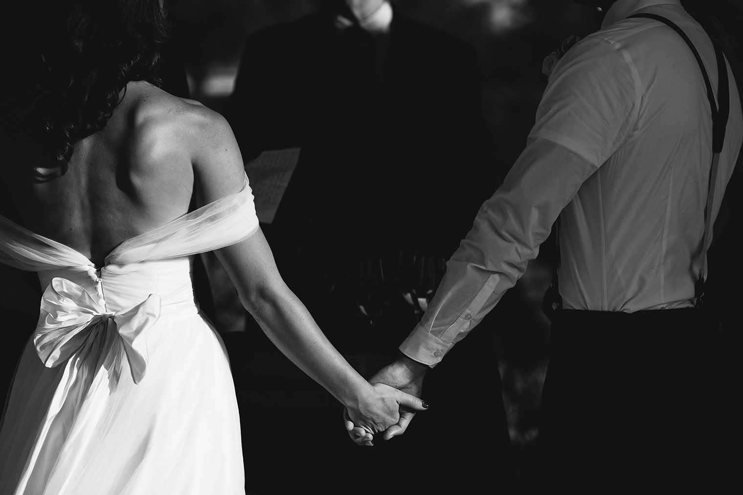 bride and groom holding hands at farmstead at long meadow ranch wedding