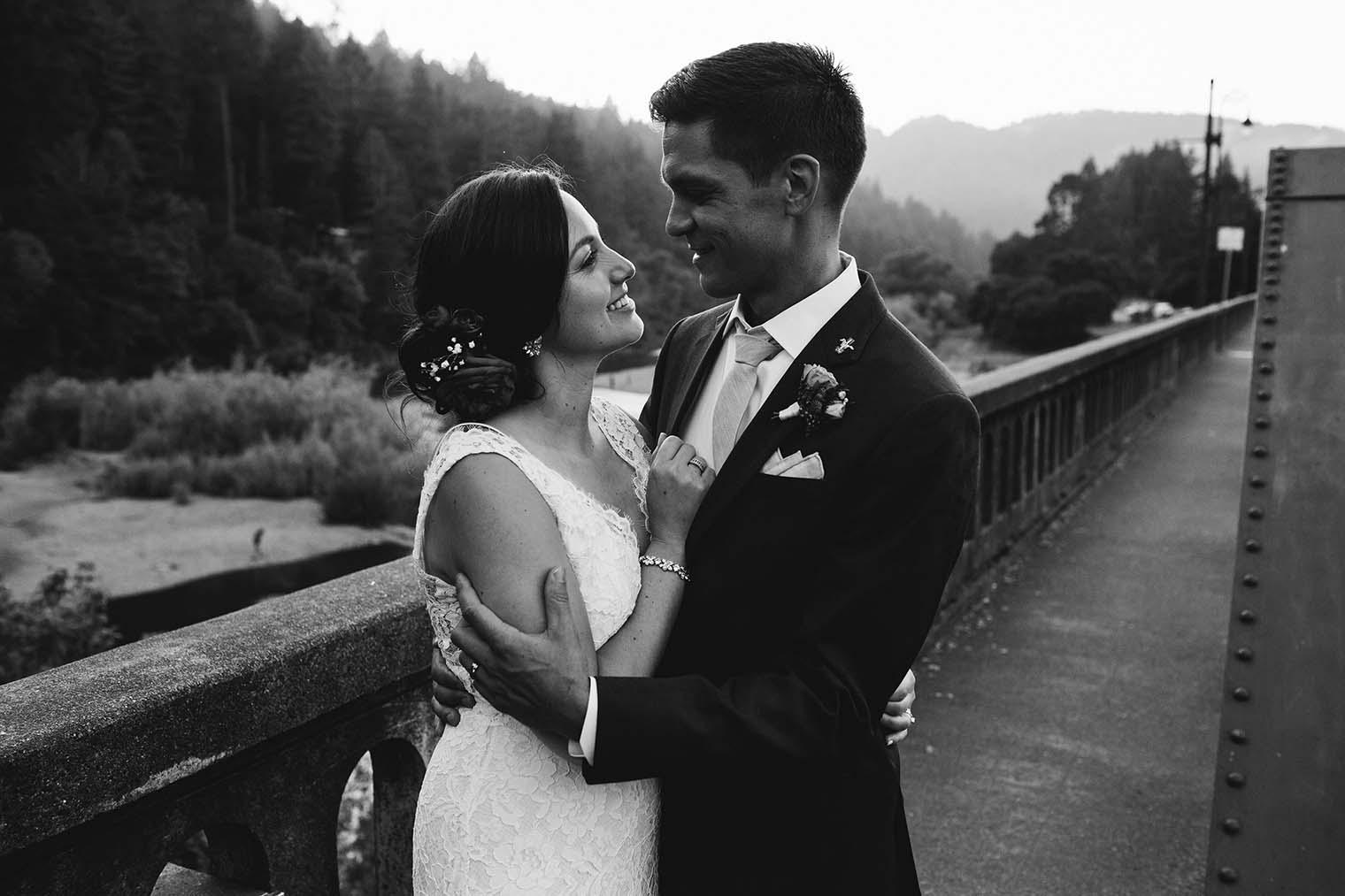bride and groom on russian river bridge