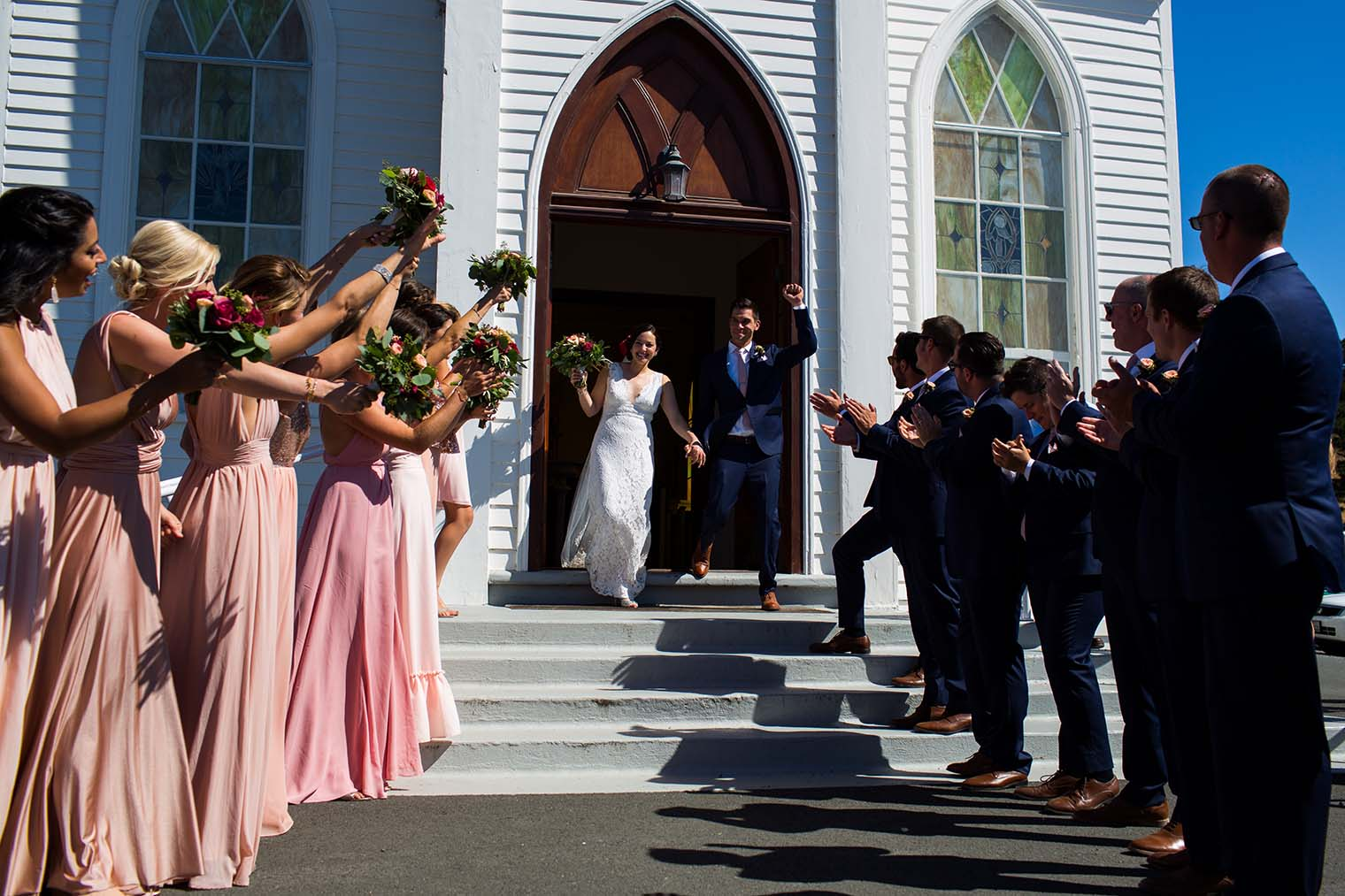 bride and groom leaving Saint Teresa of Avila Church