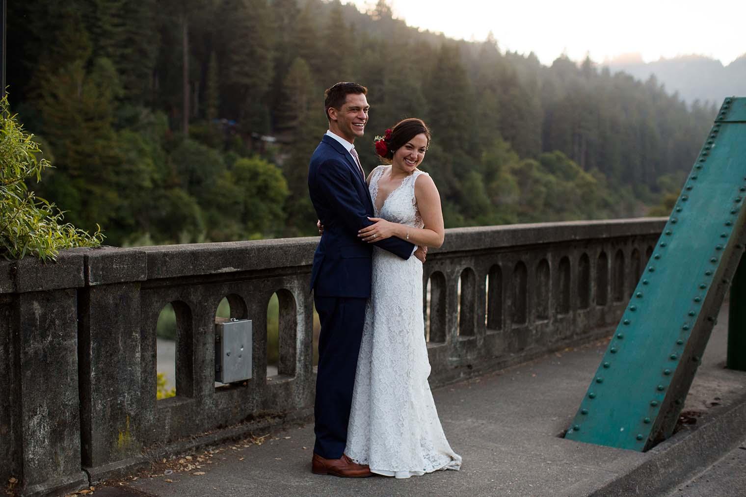 bride and groom portraits on Russian river bridge